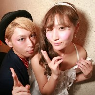 A cool Japanese couple posing at the Trump Room's Halloween party.