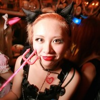 Japanese girl in her classic black devil Halloween outfit.