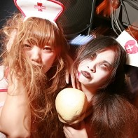 Two girls dressed up as scary nurses.