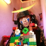 An elaborate DIY Halloween costume with Lego blocks worn by a Japanese guy.