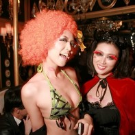 Costumed Japanese girls having fun at the Noir Halloween party.