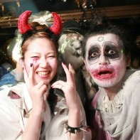 Another Japanese couple posing in their Halloween outfits on the dance floor.