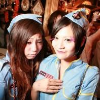 Two girls in light blue stewardess uniforms.