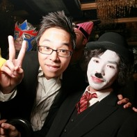 Japanese guy next to a Japanese Charlie Chaplin giving the v-sign.